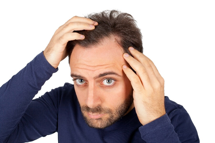 Could alcohol be the cause of your hair loss? Read on to find out what the research has to say.